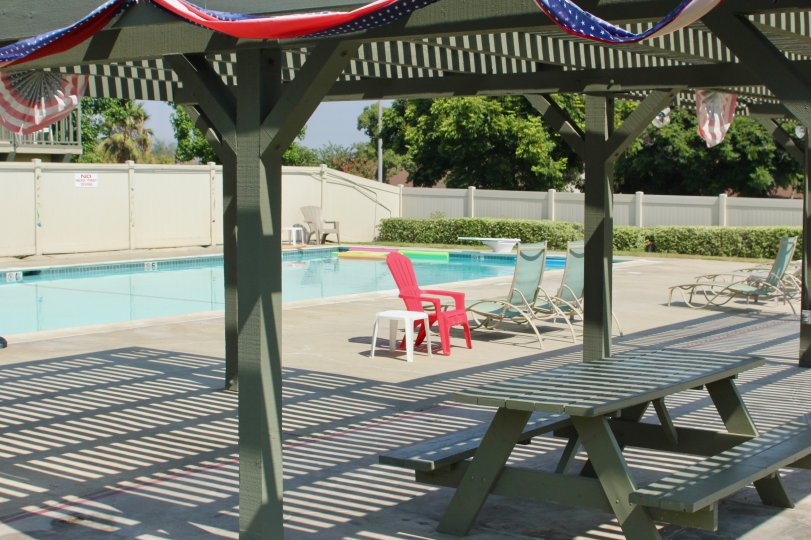 The village grove townhomes are with swimmingfool and sunbath chairs facility