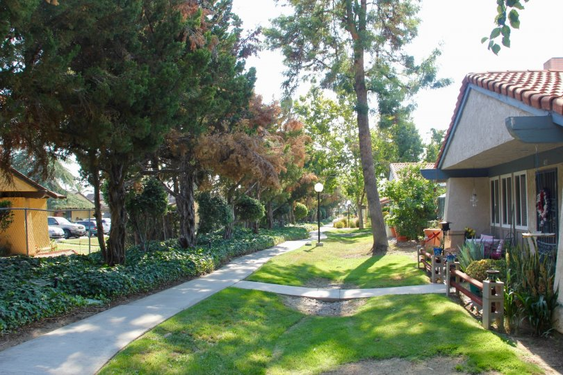 Walking path with trees and lawn in the Echo Hills community of Hemet, CA