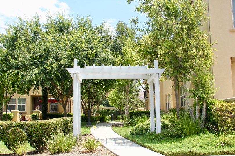 Pretty walkway with Pagonia and trees, trimmed shrubs and landscaped gardens throughout the grounds