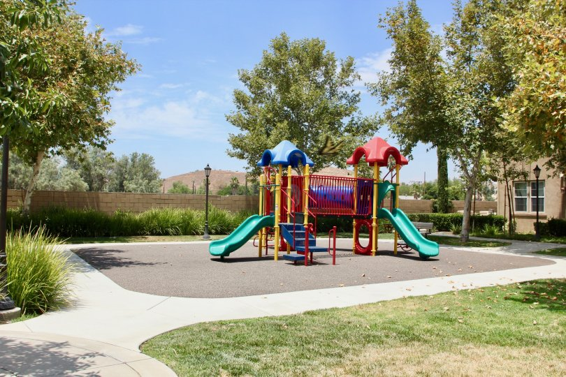 A sunny day in the Belcaro park with children's playground and picnic tables