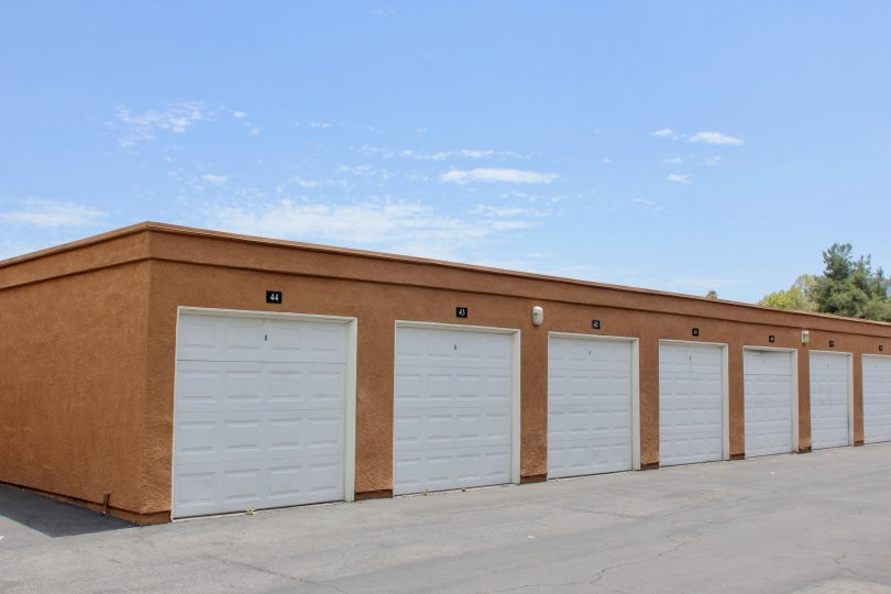 Storage units or garages for the use of residents boxy orange structure with parking lot