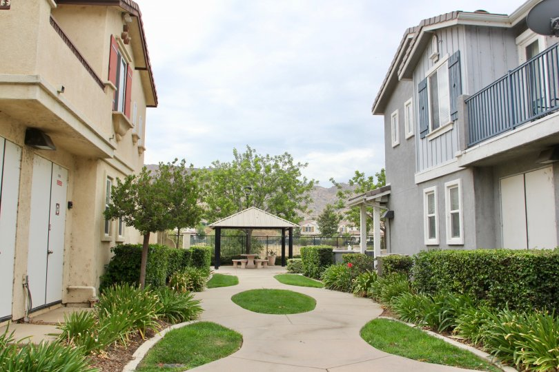 Grey and tan townhomes line the path to the covered table at Iris Landing