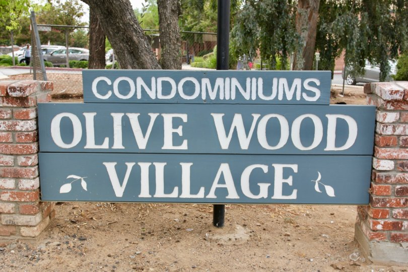 Large sign for the Olive wood Village Condominiums