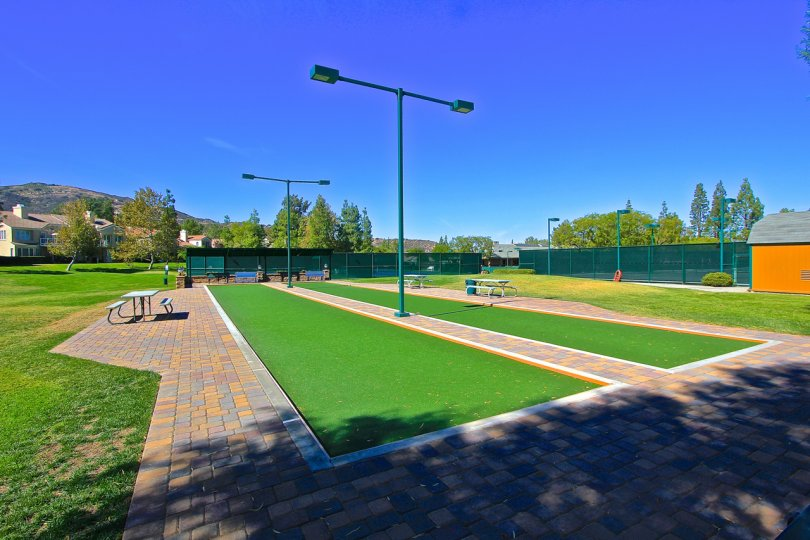 Bocce courts at Country Club Villas at Bear Creek on a under bright blue sky