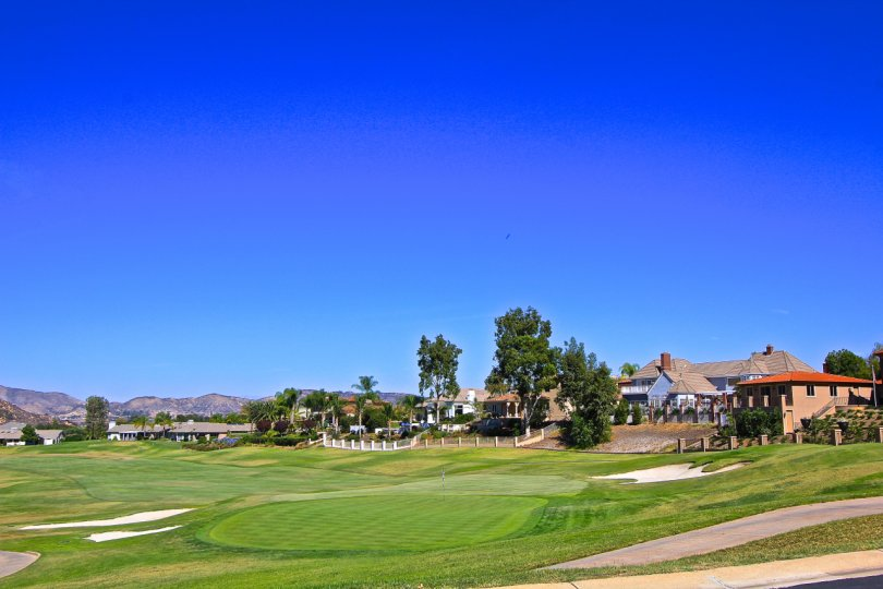 A view of the bright green golf course at Country Club Villas located in Bear Creek.