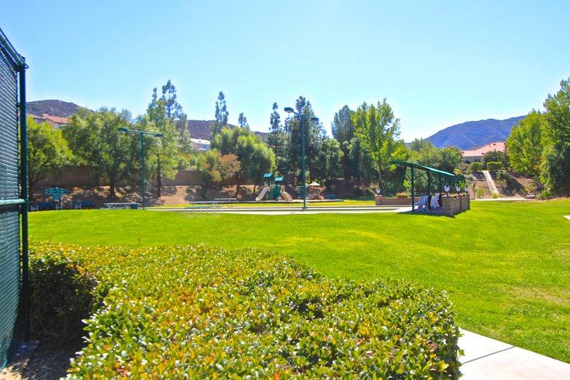 Country Club Villas at Bear Creek has nice trees and quaint playground.