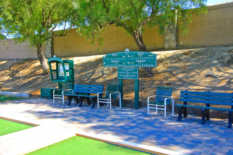 Scoreboard and benches surround the lawn bowling courts of Country Club Villas at Bear Creek