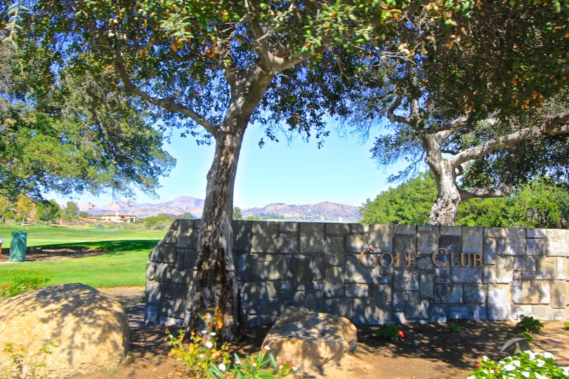 Golf Club is visible on a stone wall at Country Club Villas at Bear Creek.
