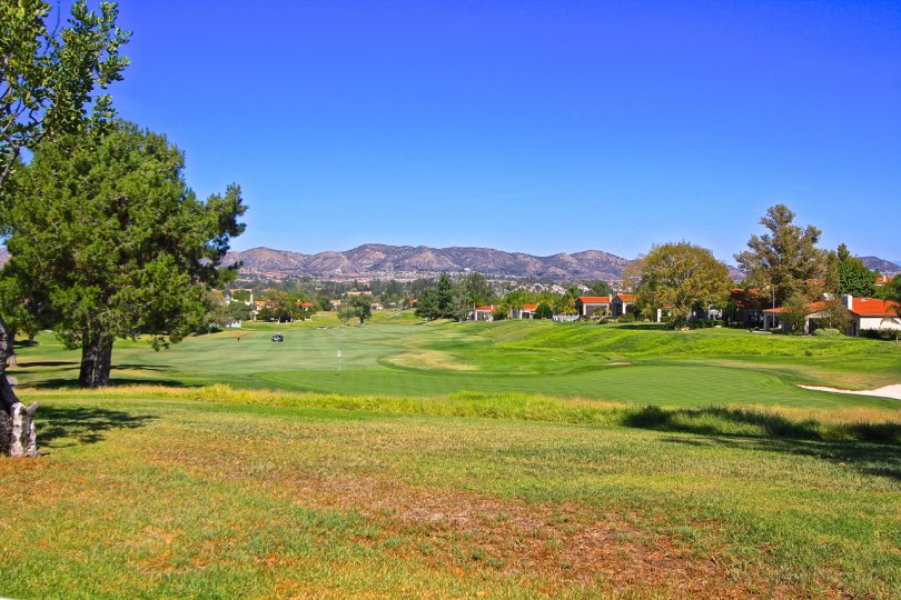 Serene mountain views overlook the golf course on this cloudless day in Country Club Villas at Bear Creek in Murrieta, California