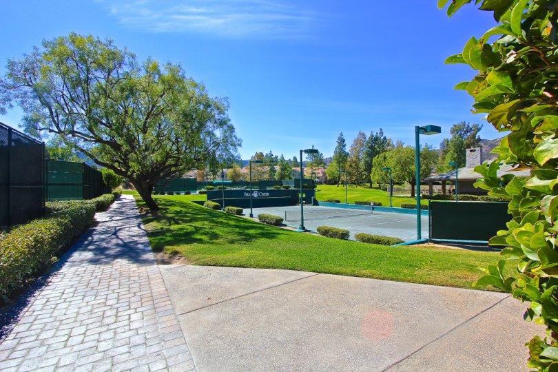 A beautiful walkway beside a tennis court in Fairway Estates at Bear Creek in Murrieta, California