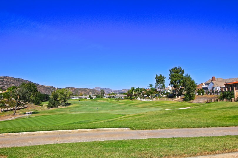 A bright, sunny day at the Fairway Estates at Bear Creek with a golf course and surrounding homes.