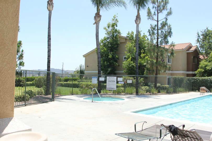The madison park villas are with palm trees and also with swimmingpool
