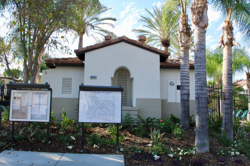 Montego Bay clubhouse in Murrieta, CA includes happenings board and map of community