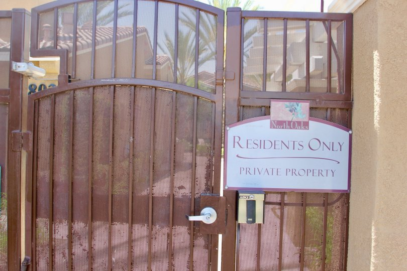 "Brown gate with ""Residents Only, Private Property"" to the North Oaks section of Murrieta, California"