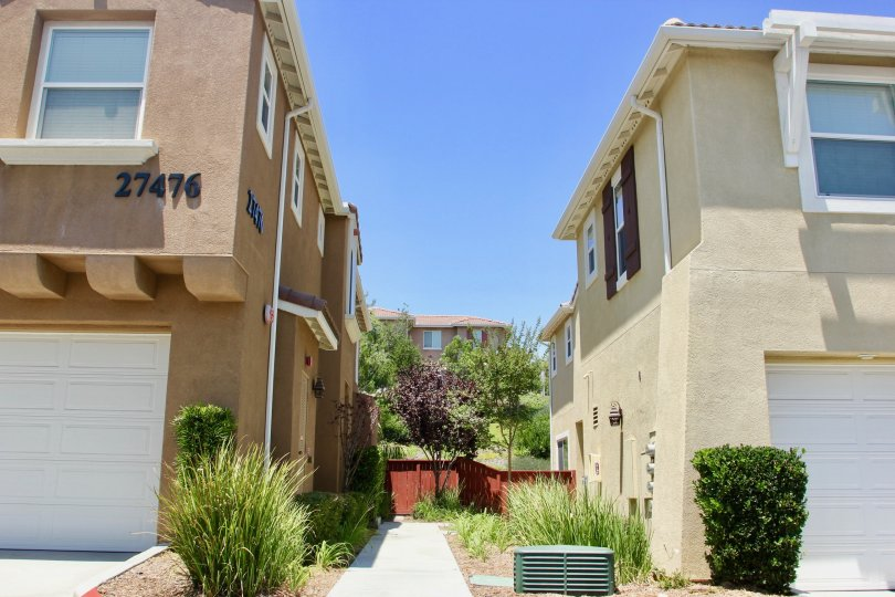neat walk way and brown, creamy walls of the apartment buildings at North Oaks community, murrieta, California