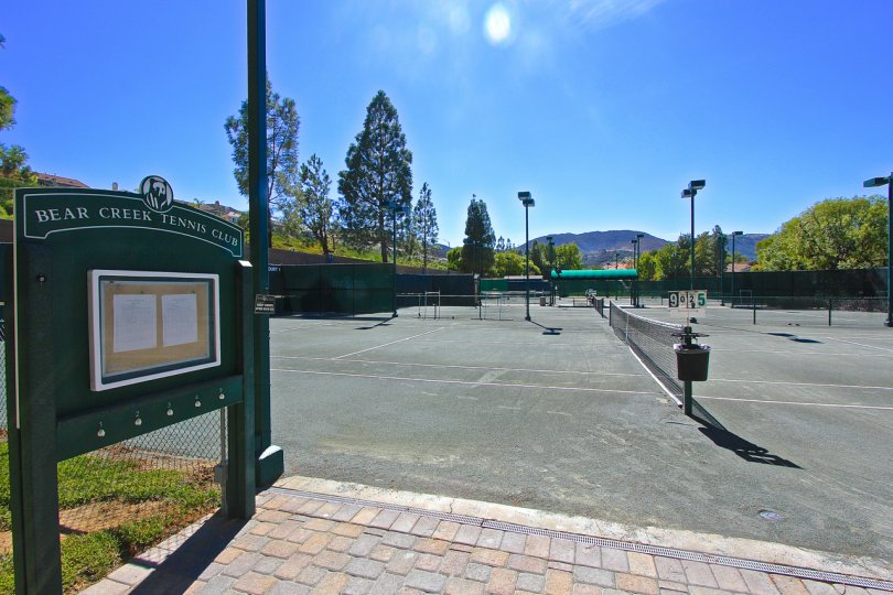 A sunny day at the serene tennis club where you can play tennis and enjoy the mountain air.