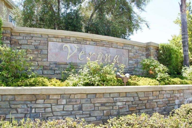Cascading garden rings showcase the main entrance sign to the Verona Community