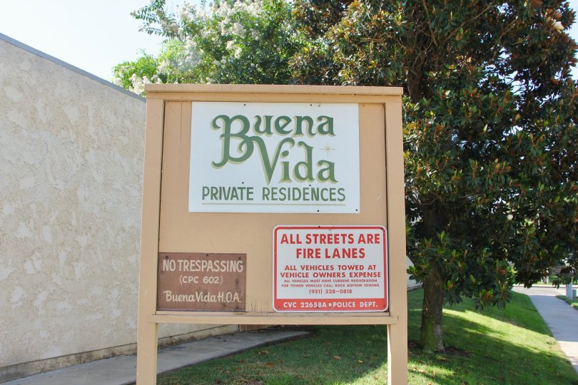 Grassy and tree lined gated area entrance to buena vida