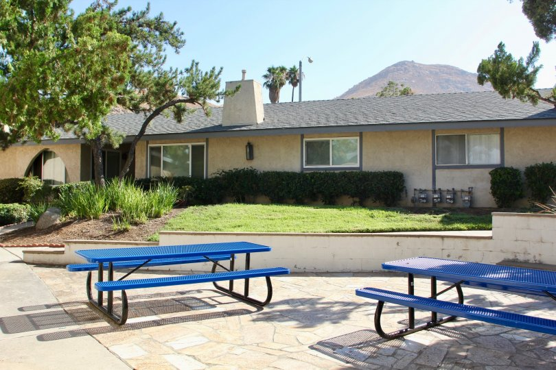 blue seats, green lawn and cute bungalows of Casa De Oro, riverside, California
