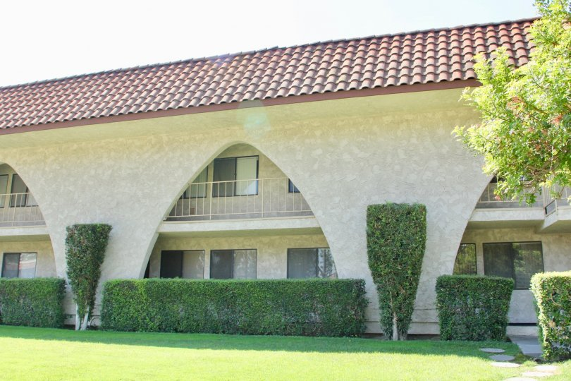 Arches reach from the bottom to the second floor on a condo building at Country Club Villas.