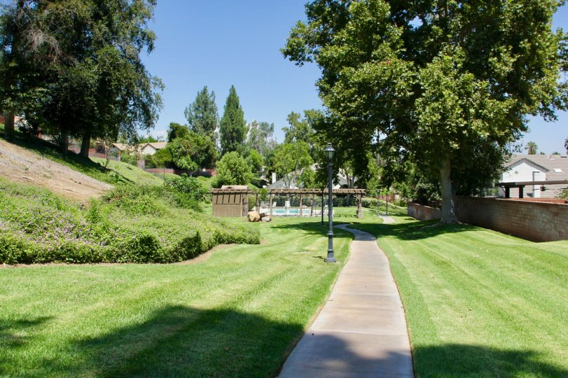 A walkway sits partially in the shade at the Crawford Country Estates.
