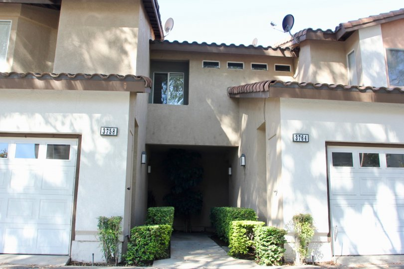 Two adjacent garages, addresses 3758 and 3764 at the Four Seasons Villas in Riverside California