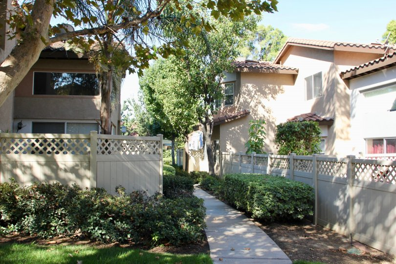 Four Seasons Villas 's clean walk way with flowers, riverside, californiia