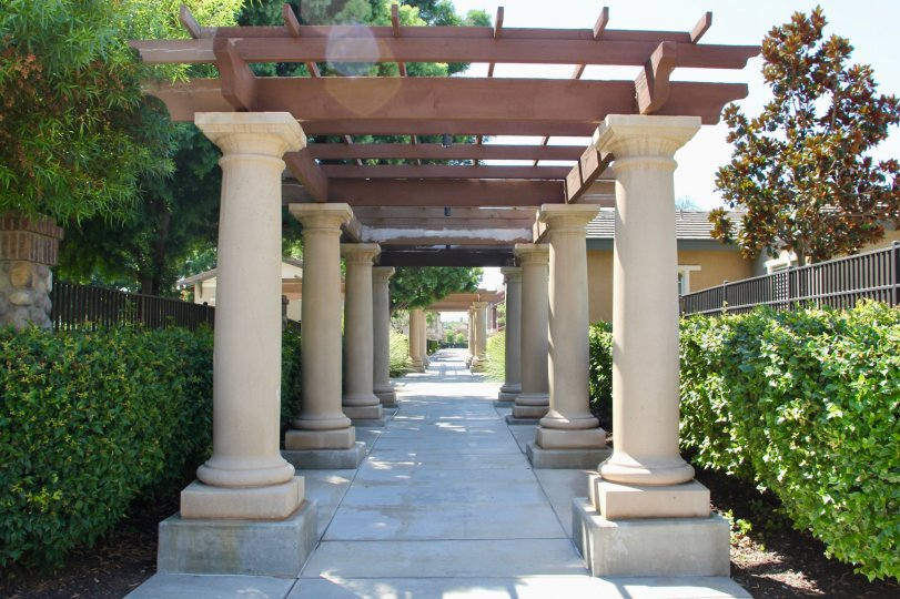 the image contains the lots of pillars and the pillars are beautiful and the walking area are nice to walk with beautiful gardenary,