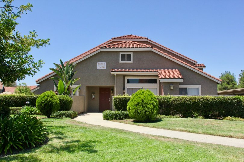 an awesomely brown walled edifice with red roof at Mission Villas, riverside, California