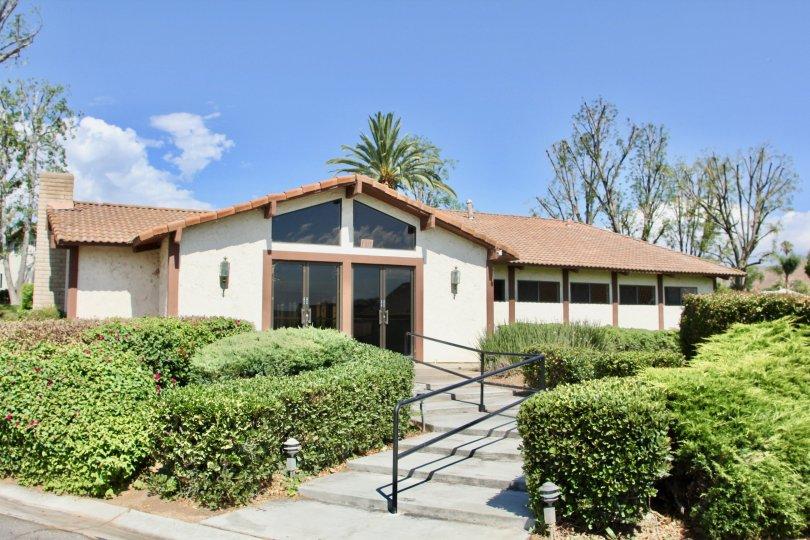 Large, floor to roof windows greet visitors to the entrance of Orangewood Villas in Riverside, California