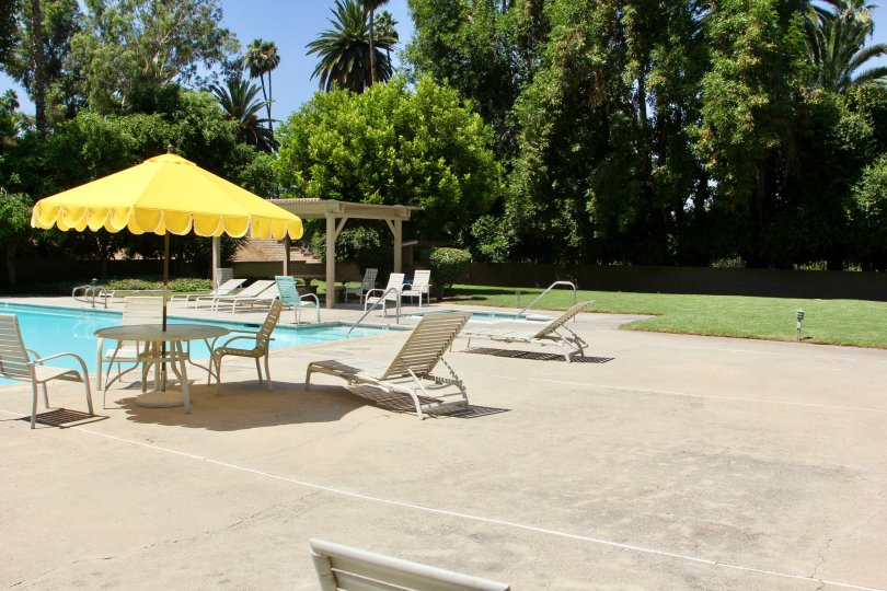 Come sit poolside in Riverside California at the gorgeous Palm Terrace neighborhood.