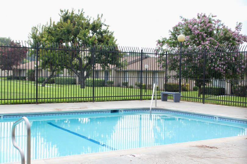 Well gated swimming pool facility for residents of Plaza West, Riverside, California