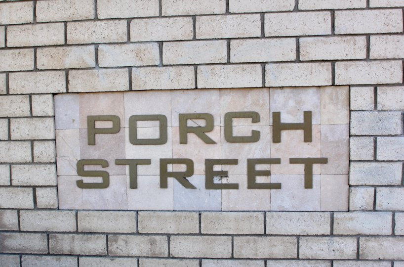 A brick wall with a sign saying Porch Street on it. Found in Riverside, California.