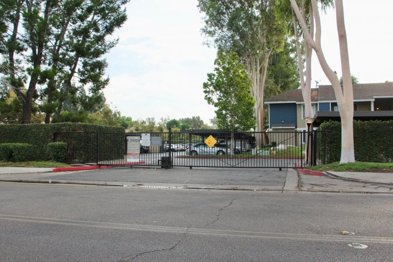 A gated parking space with shed in River Oaks community.
