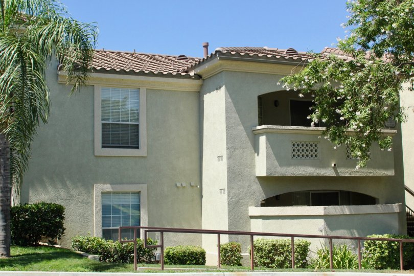 A low-rise housing with an arched balconies in Sonata at Canyon Crest community.