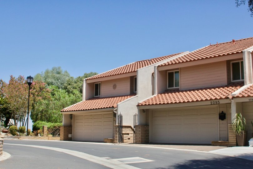 Two units with front sloping ceramic tile roofs in the Sunset Ridge community.