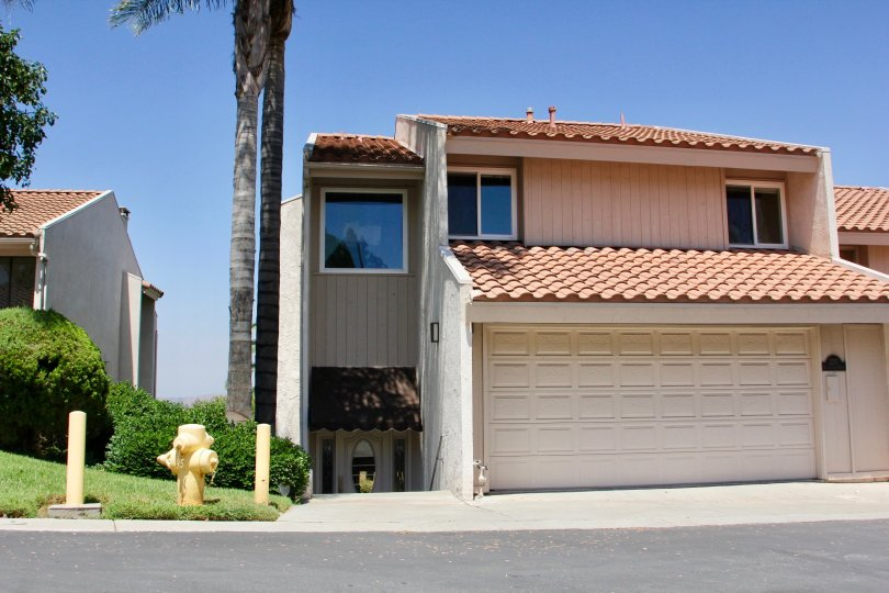 Entrance and garage door of a home in the Sunset Ridge community of Riverside, California