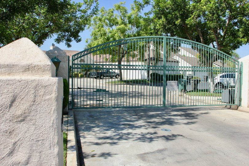 The outer entrance gate at Victoria Fairways located in Riverside, California. It is a beautiful sunny day.