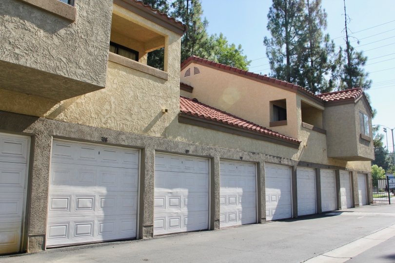 Row of single-car garages at the Woodlands community in Riverside, California