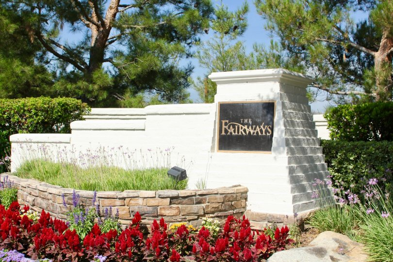 Entrance with garden landscaping and rock wall for Fairways