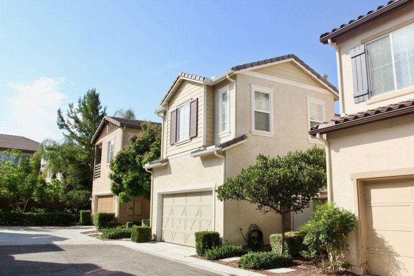 The front of a two story home in the community of Hawthorne, interspersed by trees, in the city of Temecula, California