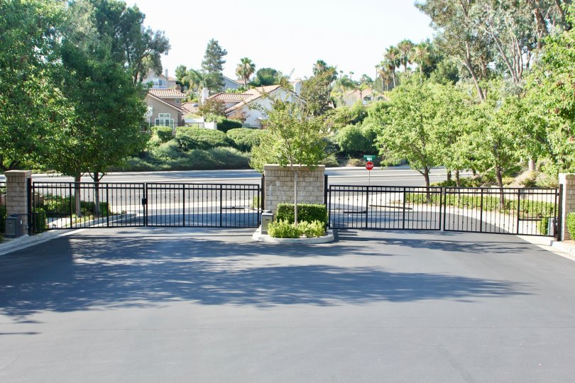 gated private entrance lined with trees and landscaping at Laurel Creek