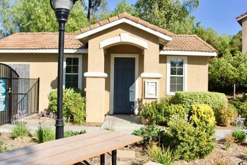 Laurel Creek temecula California mild painted isolated house with light post in front and bussy grass