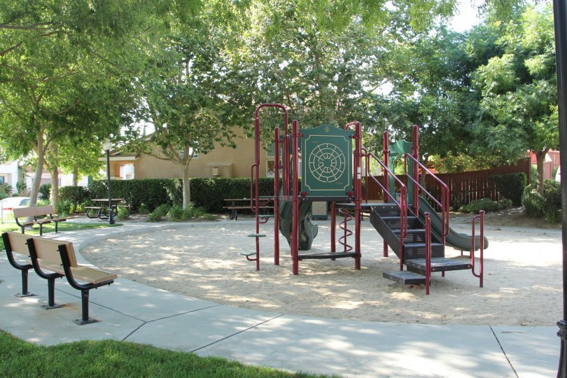 Slides and benches and community buiding in Laurel Creek Childrens Park in Temecula California