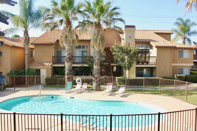Beautiful Palm Valley Condos with swimming pool and palm trees