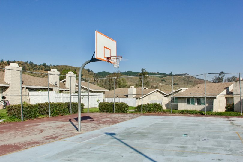 Basketball court over serene mountain views and sunny skies at Rancho Meadows in Temecula, CA