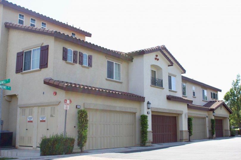 Beautiful Spanish-style building with dark brown garage doors
