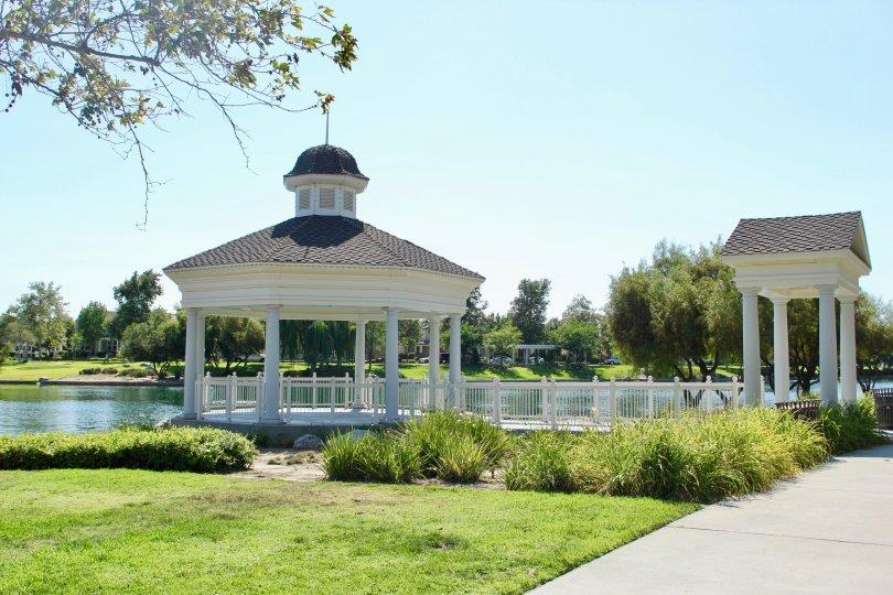 Savannah at Harveston temecula California very nice building come to direct sun shine near to big lake and green grasses tree