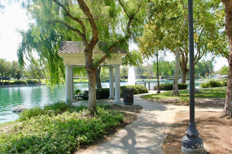 A winding walkway along a large emerald lake inside Savannah at Harveston.