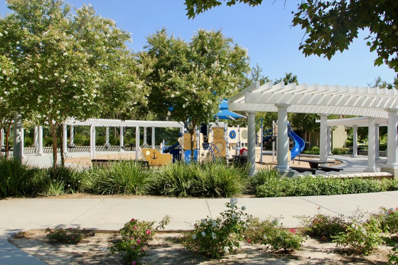 Children's play area surrounded by gazebos at Savannah at Harveston in Temecula, California